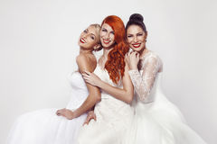 Portrait of a three beautiful woman in wedding dress Stock Photography