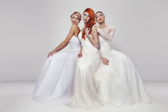 Portrait of a three beautiful woman in wedding dress Stock Images