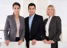 Portrait of three business people: man and woman in a team. Stock Photo