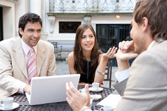 Business people meeting in cafe. Royalty Free Stock Photo
