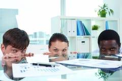 Three employees Royalty Free Stock Photos