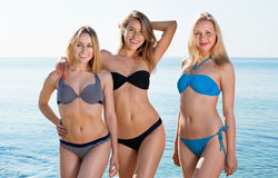 Portrait of three cheerful  young women on  beach Royalty Free Stock Photos