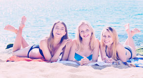 Portrait of three cheerful young women  on beach Stock Photography
