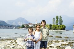 Portrait of three children brothers and sister in outdoor on the. Shores of Lake Maggiore Italy tourists in the summer Stock Photography