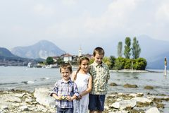 Portrait of three children brothers and sister in outdoor on the. Shores of Lake Maggiore Italy tourists in the summer Royalty Free Stock Photography
