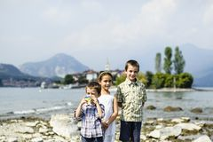 Portrait of three children brothers and sister in outdoor on the. Shores of Lake Maggiore Italy tourists in the summer Royalty Free Stock Images