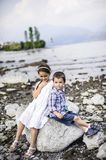 Portrait of three children brothers and sister in outdoor on the. Shores of Lake Maggiore Italy tourists in the summer Stock Photo