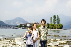 Portrait of three children brothers and sister in outdoor on the. Shores of Lake Maggiore Italy tourists in the summer Stock Images