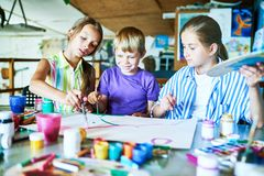 Children Painting in Art Class stock image