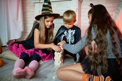 Children Playing Board Games at Halloween Party stock photo