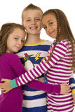 Portrait of three cute children wearing Christmas pajamas Stock Images