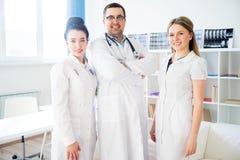 Portrait of three doctors Stock Photos