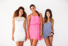 Portrait Of Three Female Friends Leaning Against Wall Royalty Free Stock Image