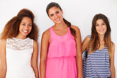 Portrait Of Three Female Friends Leaning Against Wall Royalty Free Stock Photography