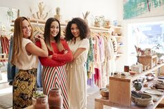 Portrait Of Three Female Sales Assistants Working In Clothing And Gift Store stock image