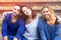 Three friends sitting on train tracks and enjoying the sun stock photos