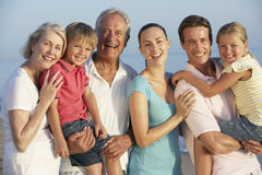 Portrait Of Three Generation Family On Beach Holiday Stock Photo