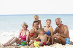 Portrait Of Three Generation Family On Beach Holiday Royalty Free Stock Photos