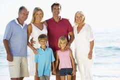 Portrait Of Three Generation Family On Beach Vacation Stock Photo