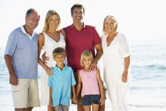 Portrait Of Three Generation Family On Beach Vacation Stock Images
