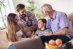 Portrait of a three generation family spending time together. At home stock images