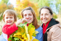Portrait of three generations. In the autumn park Stock Photography