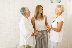 Portrait of three generations of women in the same family stock images