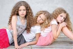 Portrait of three girlfriends Stock Photos