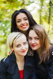 Portrait of Three Girlfriends in Park Royalty Free Stock Photo