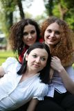 Portrait of three girls posing in the park Royalty Free Stock Photo