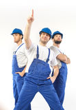 Portrait of three handsome builders Royalty Free Stock Photo