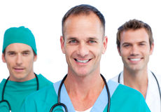 Portrait of three handsome doctors Stock Photos