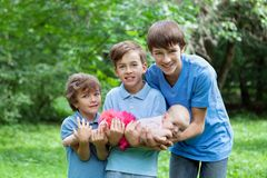 Portrait of three happy brothers and sisters Royalty Free Stock Photos