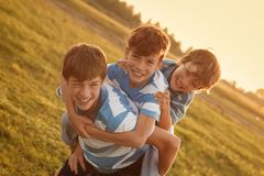 Portrait of three happy cheerful brothers Royalty Free Stock Photography