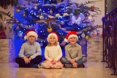 Portrait of three happy children having fun at Christmas eve Royalty Free Stock Images