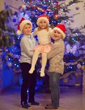 Portrait of three happy children having fun at Christmas eve Royalty Free Stock Photo