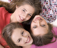 Portrait of three  happy girls. Portrait of three young beautiful happy girls Royalty Free Stock Photography