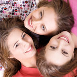 Portrait of three  happy girls. Portrait of three young beautiful happy girls Stock Photo