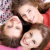 Portrait of three  happy girls. Portrait of three young beautiful happy girls Stock Photos