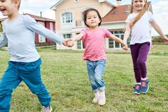 Happy Kids Playing Outdoors royalty free stock image