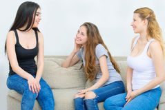 Portrait of three happy pretty young women at home Royalty Free Stock Image