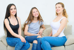 Portrait of three happy pretty young women at home Royalty Free Stock Photography
