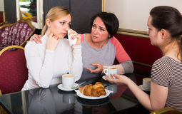 Portrait of three hectic woman sitting in the cafe Stock Photos