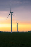 Portrait of three large wind turbines at sunset Stock Images