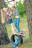 Portrait of three little girls. Portrait of young children on a camping holiday Royalty Free Stock Photography