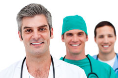 Portrait of three male doctors smiling Royalty Free Stock Photos