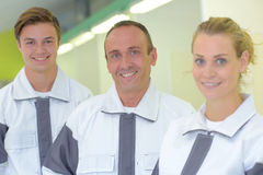 Portrait three manual workers stock photography