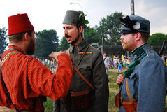 Portrait of three men in historical costumes. Royalty Free Stock Photos