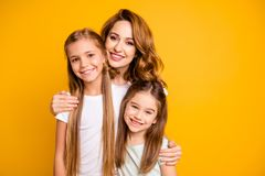 Portrait of three nice cute lovely winsome attractive cheerful cheery blonde positive people cuddling bonding relatives stock image