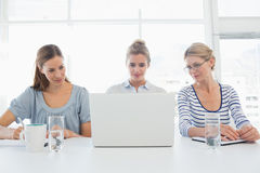 Portrait of three people working in office Stock Images